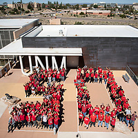 Students and staff line up to form the number 50 to celebrate 50 years of the University of New Mexico-Gallup, Thursday Sept. 27, 2018 on campus.