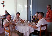 British holidaymakers men and women couples on holiday sitting around breakfast meal table in 1966