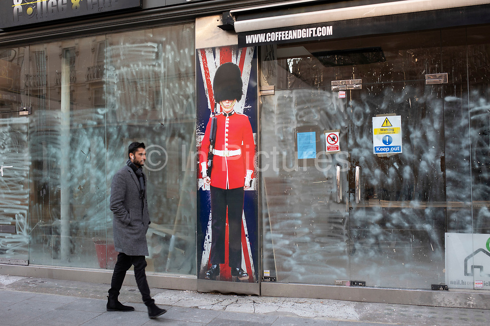Full size cut out of a Grenadier Guardsman in full military uniform outside a closed down souvenir shop on 21st January 2020 in London, England, United Kingdom. This is an iconic symbol of Britishness for the tourism industry and for Britians identity. With much economic uncertainty in the UK following Brexit and with more competition from online retailers, the high street is facing difficult times.