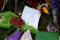 June 17, 2017 - Falcon Heights, MN, USA - United States - Flowers and messages pile up Saturday, July 17, 2017, in Falcon Heights, MN, near the site where Philando Castile was fatally shot during a traffic stop by St. Anthony police Officer Jeronimo Yanez last July. Yanez was acquitted of all charges in a verdict at the Ramsey County Courthouse Friday.]......DAVID JOLES • david.joles@startribune.com ......Yanez aftermath**Amy Brisbane,cq (Credit Image: © David Joles/Minneapolis Star Tribune via ZUMA Wire)