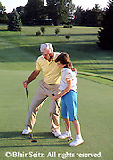 Active Aging Senior Citizens, Retired, Activities, Grandfather and Granddaughter Golf, Elderly man teaches Granddaughter Golf, Staying Young