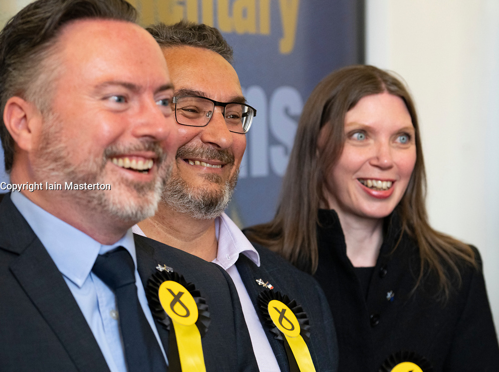 Edinburgh, Scotland, UK. 27 May, 2019. The six new Scottish MEPs are declared at the City Chambers in Edinburgh, SNP's Alyn Smith, Christian Allard and Aileen McLeod, Louis Stedman-Bruce from the Brexit Party, Sheila Ritchie of the Liberal Democrats and Baroness Nosheena Mobarik of the Conservatives. Pictured l to r SNP's Alyn Smith, Christian Allard and Aileen McLeod,