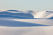 The dunes in White Sands National Monument, New Mexico, make up the largest gypsum dune field in the world. The white sand dunes are comprised of gypsum crystals, which is rarely found as sand because it is water-soluble. But the Tularosa Basin is surrounded by mountains and there is no direct outlet to the sea for any rain that falls there. Any water eventually drains through the ground leaving the gypsum behind in a crystalline form called selenite.