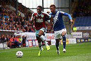 Stephen Ward of Burnley is chased by Demarai Gray of Birmingham City (r). Skybet football league championship match, Burnley  v Birmingham City at Turf Moor in Burnley, Lancs on Saturday 15th August 2015.<br /> pic by Chris Stading, Andrew Orchard sports photography.