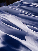 Wind-sculpted snow or sastrugi at the edge of the Paunsaugunt Plateau near Upper Inspiration Point, Bryce Canyon National Park, Utah.