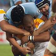 The Waratahs defence hold out Arizona Taumalolo of the Chiefs during the Super14 match between the Waratahs and the Chiefs at the Sydney Football Stadium in Sydney, Australia on February 20, 2009. The Waratahs won the match 11-7. Photo Tim Clayton