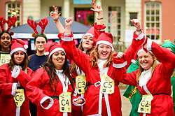 © Licensed to London News Pictures. 08/12/2018. LONDON, UK.  Competitors take part in The 38th Great Christmas Pudding Race in Covent Garden, raising funds for Cancer Research as well as having a lot of festive fun.  Photo credit: Stephen Chung/LNP