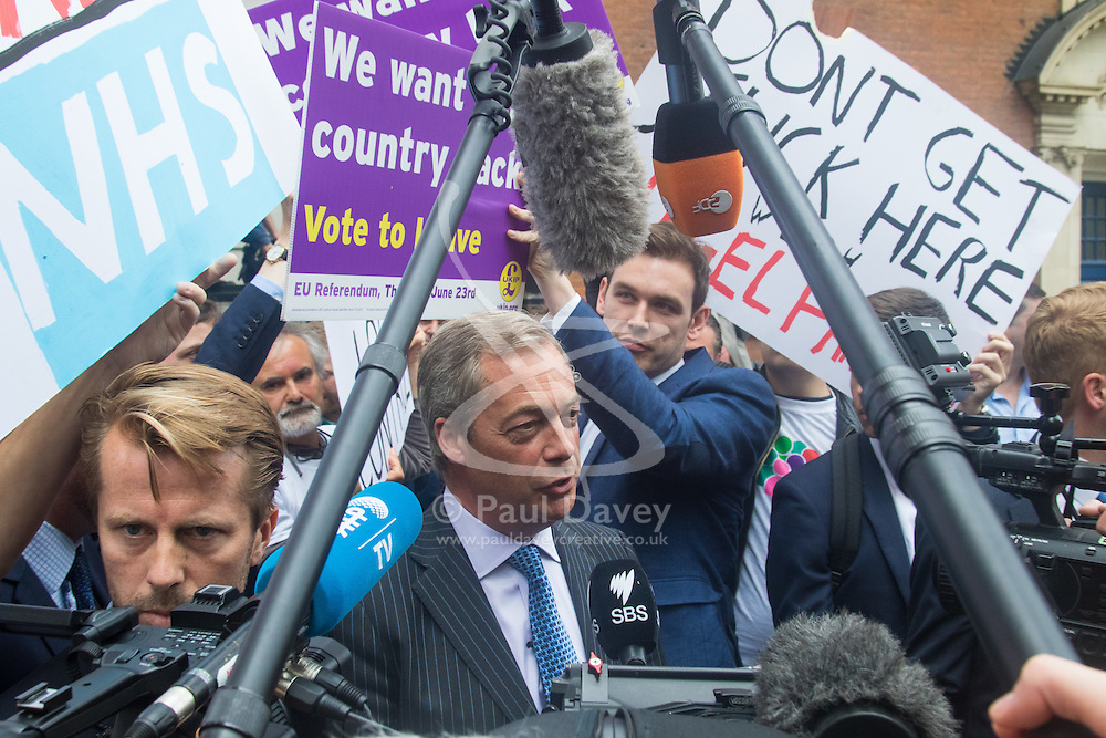 """Smith Square, Westminster, London, June 16th 2016. UKIP leader Nigel Farage launches his """"biggest ever"""" advertising campaign as Leave and Remain enter their last week of campaigning before the EU referendum on June 23rd. PICTURED: Nigel Farage speaks to the media as Remain campaigners get their posters in front of the cameras."""