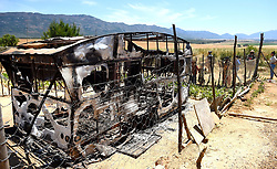SOUTH AFRICA - Cape Town - 25 October 2020- A caravan where the alleged serial killer was living in,was set alight by community members when he was caught red handed with a body of a woman in Pineville township in Wolsely.According to witnesses the man had carried out a body of a female around 10pm when a neigbhour noticed that there was something wrong and she called community members.They later set his caravan where he was living in alight. Photograph; Phando Jikelo/African News Agency(ANA)