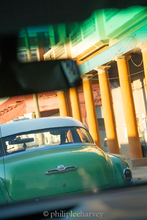 View of car on street from other car interior, Havana, Cuba