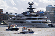"""The superyacht 'Kismet' is moored opposite Butler's Wharf, downstream from Tower Bridge where passing small boats travel past on the river Thames, on 20th October 2021, in London, England. 'Kismet' is a 95.2m (312 ft)-long superyacht which was built in 2014. It is managed by the Moran Yacht & Ship chartering business, and is owned by Pakistani-American billionaire Shahid Khan. 'Kismet' means """"destiny"""" or """"fate"""" in Khan's native Urdu."""