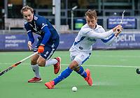 AMSTELVEEN - Boet Phijffer (Kampong) met links Pepijn Scheen (Pinoke)   tijdens de hoofdklasse hockeywedstrijd mannen, Pinoke-Kampong (2-5) . COPYRIGHT KOEN SUYK