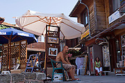 Nesebar, Bulgaria..Souvenir sellers in the 5,000 year old town of Nesebar, which is overwhelmed by tourists from neighbouring Sunny Beach every year.
