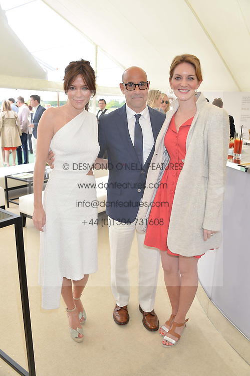 Left to right, ANNA FRIEL, STANLEY TUCCI and his wife FELICITY at the St.Regis International Polo Cup at Cowdray Park, Midhurst, West Sussex on 17th May 2014.