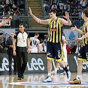 Fenerbahce's Darjus LAVRINOVIC (C) and Omer ONAN (L) celebrate victory during their Turkish Basketball Legague Play-Off semi final second match Efes Pilsen between Fenerbahce at the Sinan Erdem Arena in Istanbul Turkey on Friday 27 May 2011. Photo by TURKPIX