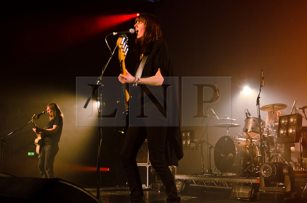 © Licensed to London News Pictures. 06/03/2012. London, UK. Band of Skulls headline a sell-out live show at The Roundhouse, Camden.  L to R - Russell Marsden, Emma Richardson, Matt Hayward.  Photo credit : Richard Isaac/LNP
