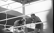 Ali vs Lewis Fight, Croke Park,Dublin..1972..19.07.1972..07.19.1972..19th July 1972..As part of his built up for a World Championship attempt against the current champion, 'Smokin' Joe Frazier,Muhammad Ali fought Al 'Blue' Lewis at Croke Park,Dublin,Ireland. Muhammad Ali won the fight with a TKO when the fight was stopped in the eleventh round...Ducking and diving Ali tries to avoid the Lewis left.