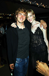Model JADE PARFITT and TOBY BURGESS at an exclusive evening featuring the greatest talents in fashion today in aid of the African children who have been affected bt the AIDS epidemic held at the Chelsea Gardener, Sydney Street, London on 20th September 2004<br /><br />NON EXCLUSIVE - WORLD RIGHTS