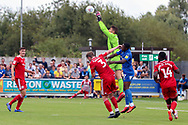AFC Wimbledon attacker Michael Folivi (17) battles for possession with Accrington Stanley goalkeeper Dimitar Evtimov (1) during the EFL Sky Bet League 1 match between AFC Wimbledon and Accrington Stanley at the Cherry Red Records Stadium, Kingston, England on 17 August 2019.