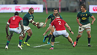 Rugby Union - 2021 British & Irish Lions Tour of South Africa - Second Test: South Africa vs British & Irish Lions<br /> <br /> Bongi Mbonambi on the attack supported by Handre Pollard and Eben Etzebeth, at Cape Town Stadium, Cape Town.<br /> <br /> COLORSPORT / JOHAN ORTON