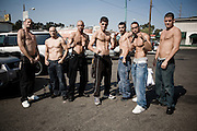 STOCKTON, CALIFORNIA - Nick and Nathan Diaz pose with students from their Cesar Gracie gym in the parking lot of Suzy's.