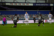 Queens Park Rangers (QPR) attacker Lyndon Dykes (9) and Queens Park Rangers (QPR) defender Dominic Ball (12) bit kneeling prior to kick off during the EFL Sky Bet Championship match between Queens Park Rangers and Rotherham United at the Kiyan Prince Foundation Stadium, London, England on 24 November 2020.