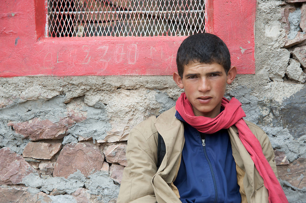 The highest mountain range in North Africa, the High Atlas runs diagonally across Morocco.  The Toubkal region contains the highest peaks.  It is only two hours from Marrakesh.  Here, a young man poses for a portrait in the Atlas mountains of Morocco.