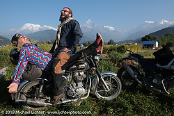 Bean're and Bear having a laugh with a spectacular background of 23,000' peaks on day-4 our our Himalayan Heroes adventure riding from Pokhara to Kalopani, Nepal. Friday, November 9, 2018. Photography ©2018 Michael Lichter.