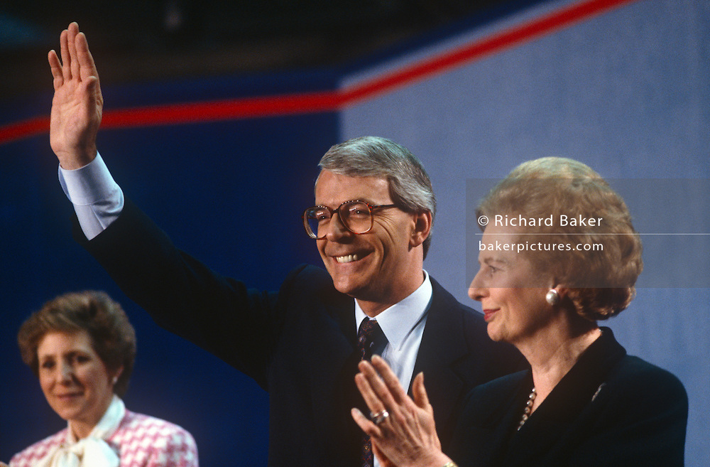 British Prime Minister, John Major is joined on stage by his wife Norma (left) and political predecessor, Margaret Thatcher during a Conservative party election rally on 23rd March 1992, in Brighton, England. Major went on to win the election weeks later and was the fourth consecutive victory for the Conservative Party although it was its last outright win until 2015 after Labour's 1997 win for Tony Blair.