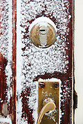 Frozen door locks on the Noorderlicht, a Dutch Schooner. Each year the Nooderlicht is frozen into the ice in Spitsbergen, and serves as an excellent base camp in the wilderness, perfect for spotting polar bears. Spitsbergen is the largest island of the arctic archipelago Svalbard, of Norway