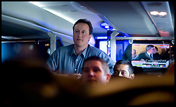 Leader of the Conservative Party David Cameron watches the Prime Minister being heckled on Sky News while on the campaign bus on the way to visit a hospital in Stevenage during his general election campaign, Saturday May 1, 2010. Photo By Andrew Parsons / i-Images.