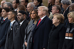 Prime Minister of Canada Justin Trudeau, Morocco's King Mohammed VI and his son, first lady Melania Trump, U.S. President Donald Trump, German Chancellor Angela Merkel, Emmanuel Macron and Brigitte Macron, Russian President Vladimir Putin.<br /> French President Emmanuel Macron and Brigitte Macron, German Chancellor Angela Merkel, U.S. President Donald Trump, first lady Melania Trump, Morocco's King Mohammed VI, Russian President Vladimir Putin, Australian Governor-General Peter Cosgrove attend a commemoration ceremony for Armistice Day, 100 years after the end of the First World War at the Arc de Triomphe.<br /> Paris,FRANCE-11/11/2018 Photo by Jacques Witt/pool/ABACAPRESS.COM