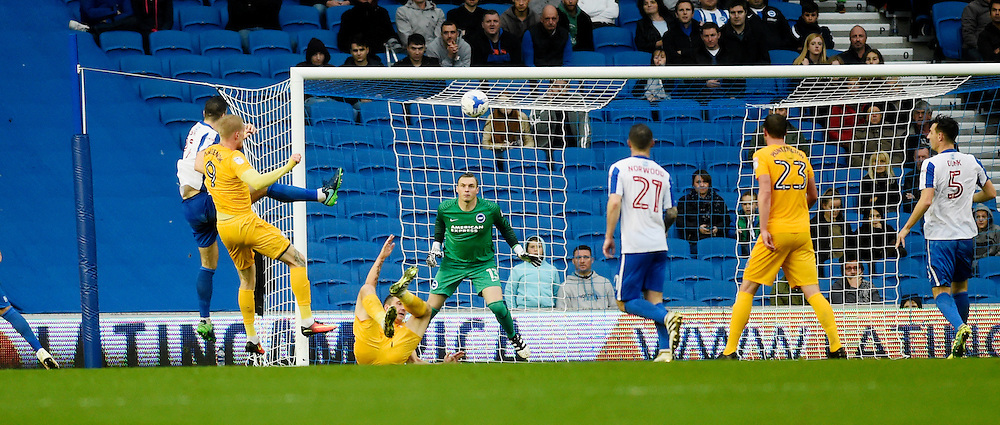 Simon Makienok of Preston  (far left) heads their late equaliser during the Sky Bet Championship match between Brighton and Hove Albion and Preston North End at the American Express Community Stadium in Brighton and Hove. October 15, 2016.<br /> Simon  Dack / Telephoto Images<br /> +44 7967 642437