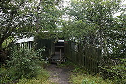 Calvert, UK. 27 July, 2020. A bird hide looks out on a lake at Calvert Jubilee Nature Reserve. On 22nd July, the Berks, Bucks and Oxon Wildlife Trust (BBOWT) reported that it had been informed of HS2's intention to take possession of part of Calvert Jubilee nature reserve, which is home to bittern, breeding tern and some of the UK's rarest butterflies, on 28th July to undertake unspecified clearance works in connection with the high-speed rail link.