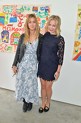 Left to right, JAZZY DE LISSER and POPPY JAMIE at a lunch in aid of the charity African Solutions to African Problems (ASAP) held at the Louise T Blouin Foundation, 3 Olaf Street, London W11 on 21st May 2014.
