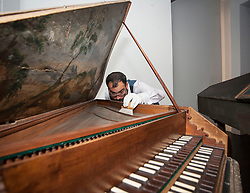 Conservator Jonathan Santa Maria Bouquet works on an ornate18th century harpsicord as part of the newly-refurbished St Cecilia's Hall, which has just undergone a 2 year, £6.5 million refurbishment which will see more of the University of Edinburgh's musical instrument collection on display to the public.<br /> © Dave Johnston/ EEm