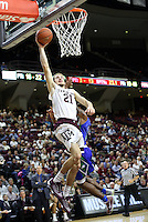 Texas A&M's Alex Caruso (21) goes up for a fast break dunk against Florida Gulf Coast University's Reggie Reid during a NCAA college basketball game in College Station, Texas, Wednesday, Dec. 2, 2015.  Texas A&M won 75-65.  (AP Photo/Sam Craft)