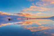 South America, Andes, Altiplano, Bolivia, Salar de Uyuni, sunset with reflections
