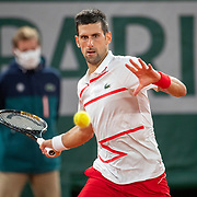 PARIS, FRANCE September 29. Novak Djokovic of Serbia in action against Mikael Ymer of Sweden in the first round of the singles competition on Court Philippe-Chatrier during the French Open Tennis Tournament at Roland Garros on September 29th 2020 in Paris, France. (Photo by Tim Clayton/Corbis via Getty Images)