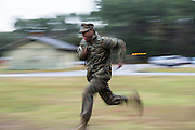 US Marine runs at the command of a drill sergeant during bootcamp January 13, 2014 in Parris Island, SC.