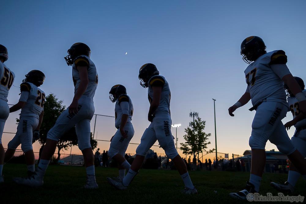 The Oak Ridge Trojans come out of the locker room before the game as the Folsom High School Bulldogs varsity football team host the Oak Ridge High School Trojans,  Friday Nov 4, 2016.<br /> photo by Brian Baer