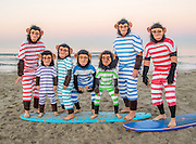 Surfers in Monkey Costumes on the Beach in Newport Beach California