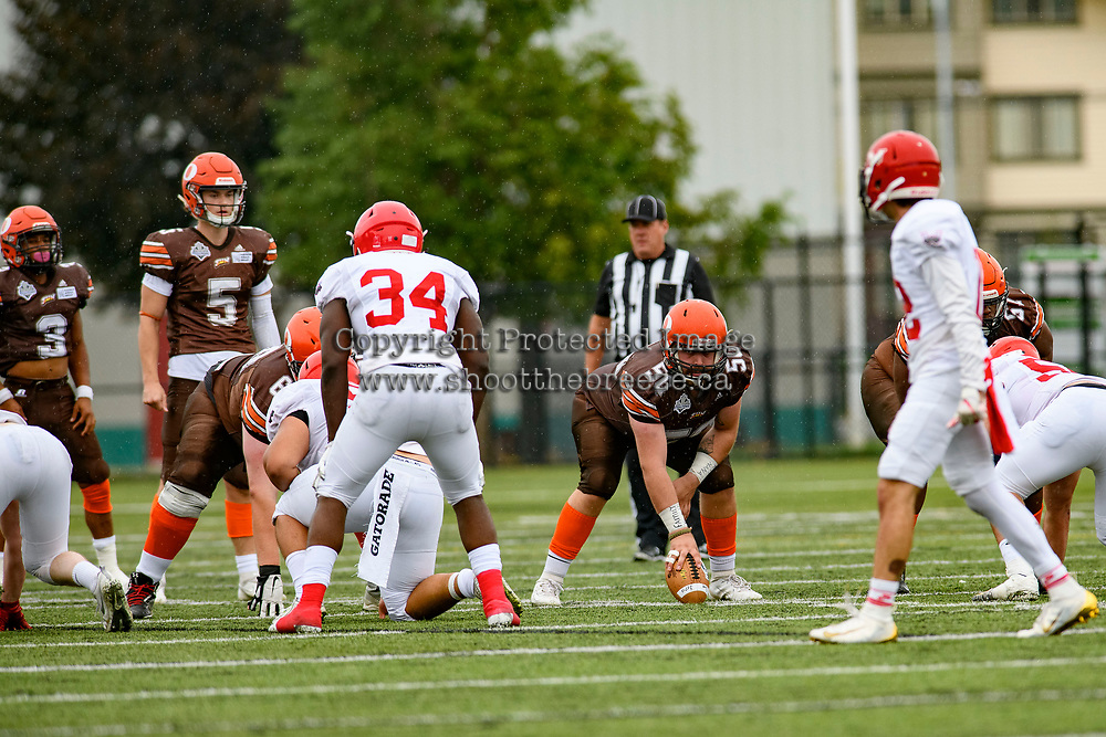 CHILLIWACK, BC - SEPTEMBER 11: Liam Hamlyn #50 readies to snap the ball to quarterback Dominic Britton #5 of Okanagan Sun against the Westshore Rebels at Exhibition Stadium in Chilliwack, BC, Canada. (Photo by Marissa Baecker/Shoot the Breeze)