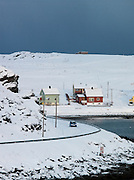 Small houses in Hovoysund.  Deliveries of supplies and transport from large cruise ships enable small communities like this to survive their isolation during winter. Havoysund is in the Finnmark region of northern Norway