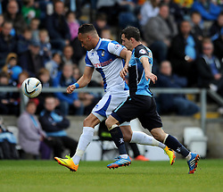 Bristol Rovers' Kaid Mohamed tugs the shirt of Wycombe Wanderers' Josh Scowen as he runs for the ball - Photo mandatory by-line: Dougie Allward/JMP - Mobile: 07966 386802 26/04/2014 - SPORT - FOOTBALL - High Wycombe - Adams Park - Wycombe Wanderers v Bristol Rovers - Sky Bet League Two