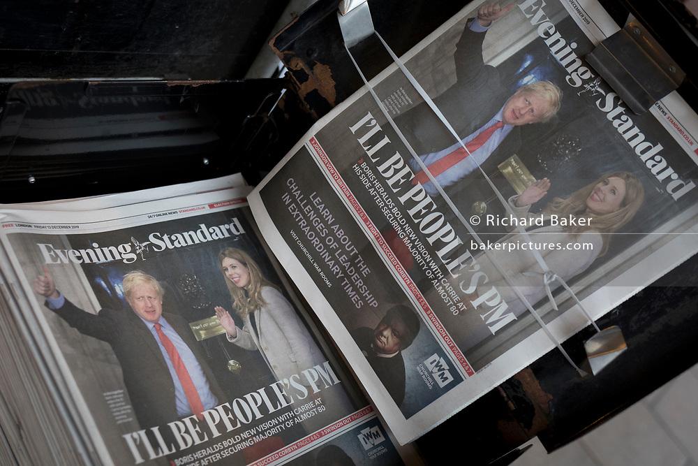 """The day after UK Prime Minister Boris Johnson's Conservative Party won a landslide general election victory, winning a majority of 80 parliamentary seats (the largest since 1987), the Evening Standard newspaper shows Johnson and his partner Carrie Symonds waving on the steps of 10 Downing Street above the headline """"I'll Be The People's PM"""", on 13th December 2019, in London, England."""