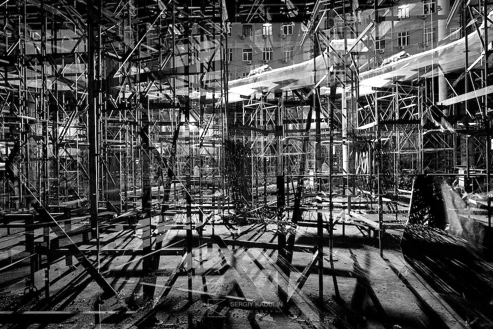 Abstract, black and white image of construction site, multi-exposition. Commercial centre construction site, Kyiv. February, 2015.