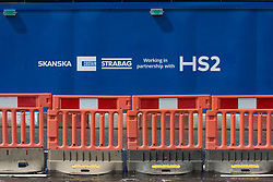 Signage on boarding around the Euston construction site for the HS2 high-speed rail link is pictured on 6th August 2021 in London, United Kingdom. SCS is a HS2 joint venture contractor formed by Skanska, Costain and Strabag.