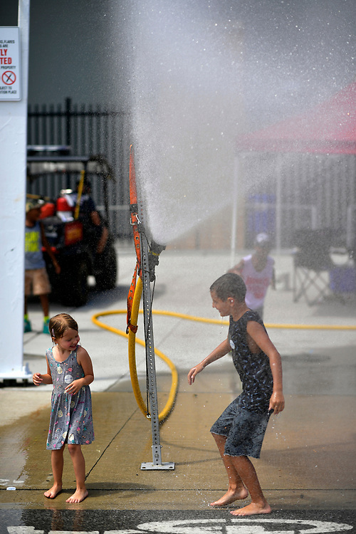 Young fan stays cool in a fire hose sprinkler, atmosphere<br /> Friday 13 July 2018<br /> Honda Indy Toronto<br /> Verizon IndyCar Series<br /> Streets of Toronto ON CAN<br /> World Copyright: Scott R LePage