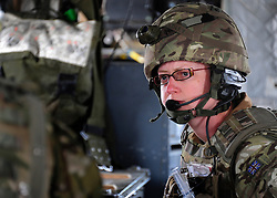© London News Pictures. 11/06/11. AFGHANISTAN. Major Clare Bradley-Hayes, the Doctor on board the MERT makes her pre flight checks as the team begin their 24 hour shift. The RAF Regiment's Medical Emergency Response Team (MERT) is made up of two teams based in 'Main Operating Base Bastion', they are responsible for extracting casualties from anywhere within Helmand Province.  The MERT consists of a doctor, an emergency department nurse and two paramedics.  In addition four Royal Air Force Regiment gunners provide armed protection when they land and leave the helicopter to collect the casualty.   Caption must read Alison Baskerville/LNP...